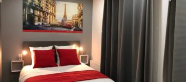 chambre deluxe - grand lit double © Hôtel Paris Clichy